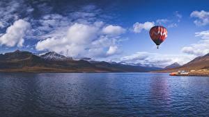 Фотографии Исландия Горы Небо Аэростат Облака Reydarfjordur Bay Природа