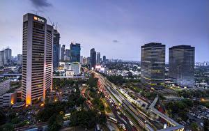 Фотографии Индонезия Дома Небоскребы Вечер Дороги Jakarta город