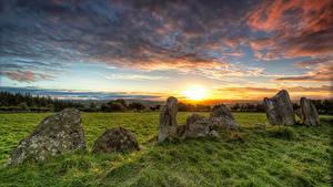 Фотография Ирландия Камень Рассветы и закаты Небо Трава Donegal Природа
