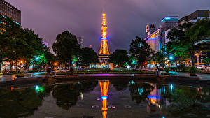 Фото Япония Дома Пруд В ночи Городская площадь Лучи света Sapporo город