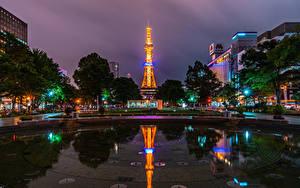 Фото Япония Дома Пруд В ночи Городская площадь Лучи света Sapporo