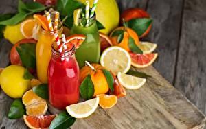 Картинка Сок Фрукты Цитрусовые Бутылки Продукты питания