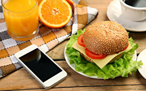 Фотографии Сок Апельсин Овощи Гамбургер Стакане Смартфон Еда