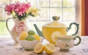 Фотографии Чайник Лимоны Чашка Вазе
