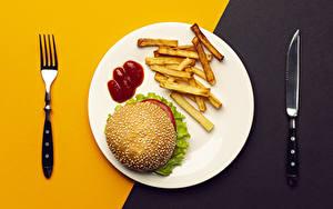 Картинки Ножик Гамбургер Картофель фри Быстрое питание Тарелке Вилки Кетчупом Пища