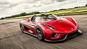 Обои для рабочего стола Koenigsegg Красная Родстер Едущий Regera Автомобили