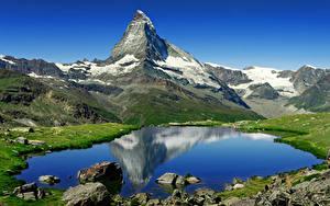 Фото Озеро Горы Камни Швейцария Альпы Matterhorn, Riffelsee Природа