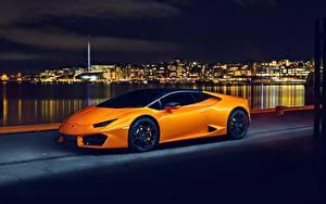 Картинки Lamborghini Оранжевых Ночь Huracan 2016 LP 580-2 машины