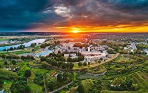 Фотография Латвия Рассветы и закаты Здания Сверху Солнце Daugavpils Города