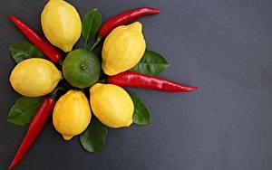 Фотография Лимоны Острый перец чили Серый фон Листья