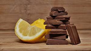 Обои для рабочего стола Лимоны Шоколад Кусочки Еда