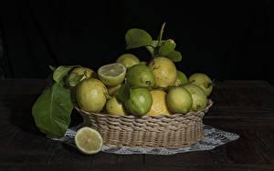 Картинки Лимоны Много На черном фоне Корзины Еда