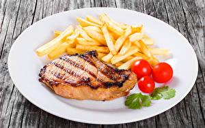 Картинки Мясные продукты Картофель фри Томаты Тарелка Продукты питания