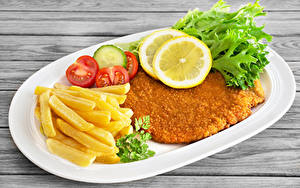 Картинки Мясные продукты Картофель фри Овощи Лимоны Быстрое питание Тарелке Пища