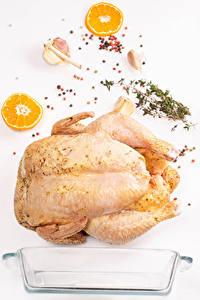 Фотографии Мясные продукты Чеснок Лимоны Перец чёрный Курятина Белым фоном Пища