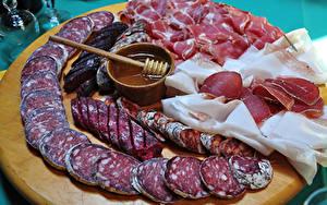 Фотография Мясные продукты Колбаса Ветчина Нарезанные продукты Пища