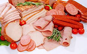 Фотография Мясные продукты Колбаса Ветчина Помидоры