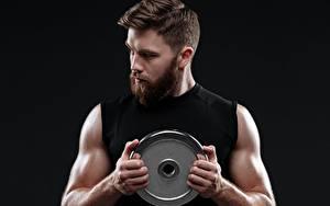 Фотография Мужчина Бородой Рука Мускулы На черном фоне