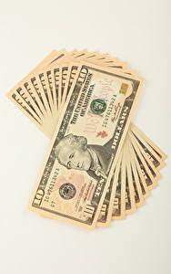Фотография Деньги Купюры Доллары Белым фоном 10