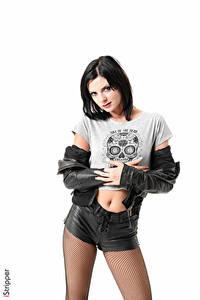 Фотография Monika Benz iStripper Белым фоном Брюнетка Смотрят Рука Куртках Шорт Колготки молодые женщины