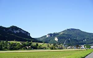 Картинка Горы Швейцария Поля Леса Село Oensingen, Solothurn Города