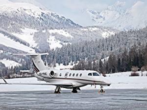 Обои Горы Зимние Леса Самолеты Швейцария Снеге Dassault Falcon 50, St. Moritz, Airfield Авиация