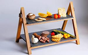 Обои Грибы Сыры Колбаса Томаты Лимоны Чеснок Хлеб Сером фоне Продукты питания