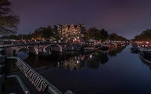 Картинки Голландия Амстердам Мосты Здания Речные суда Водный канал Города