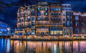 Фотографии Нидерланды Амстердам Здания Водный канал Ночные Города
