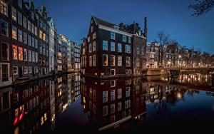 Фото Нидерланды Амстердам Дома Водный канал Ночные
