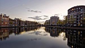 Обои Нидерланды Амстердам Здания Вечер Реки