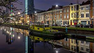 Картинки Нидерланды Здания Речные суда Набережная Уличные фонари The Hague