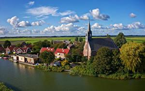 Фото Голландия Здания Реки Церковь Причалы Oudendijk Города