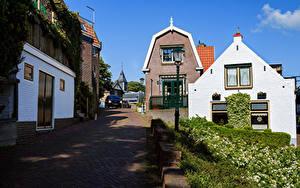 Обои Нидерланды Здания Дороги Улица Уличные фонари Urk Города