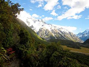 Фотографии Новая Зеландия Гора Парки Пейзаж Облако Кусты Скамейка Mount Cook National Park Природа