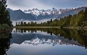 Картинки Новая Зеландия Гора Озеро Утро Отражение Деревья Lake Matheson
