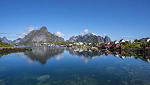Обои Норвегия Лофотенские острова Горы Дома Отражается Заливы Reine