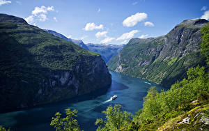 Обои для рабочего стола Норвегия Гора Залив Скалы Geiranger Fjord Природа