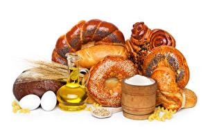 Фото Выпечка Булочки Хлеб Белым фоном Колосья Яйцами Кувшин Солью Продукты питания