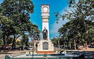 Обои Филиппины Памятники Часы Деревьев Jose Rizal monument Dumaguete Negros Island