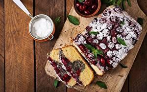 Фотографии Пирог Черешня Сахарная пудра Кусочки Продукты питания