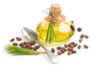 Фотография Белом фоне Бутылки Ложки Зерно Масла Pine nuts Пища