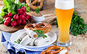 Фотографии Редис Пиво Мясные продукты Сосиска Выпечка Стакан Пена Еда