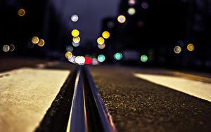 Фотографии Железные дороги Крупным планом Асфальт В ночи Рельсы