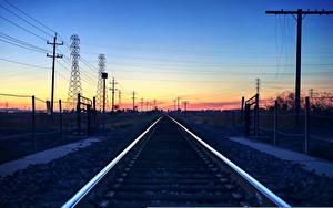 Картинка Железные дороги Рассветы и закаты Небо Рельсы