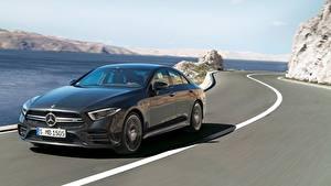 Картинка Дороги Mercedes-Benz Седан Едущая Черный AMG, CLS, 53 4MATIC, 2018 авто