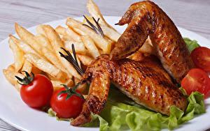 Картинка Курица запеченная Картофель фри Помидоры