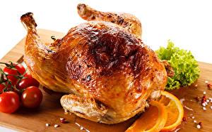 Фотография Курица запеченная Помидоры Цитрусовые Разделочной доске