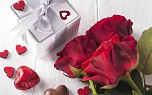Фотография Розы Конфеты День всех влюблённых Сердце Бантики Подарки Цветы