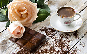 Фото Розы Кофе Шоколад Чашка Доски Блюдце Какао порошок Пища Цветы